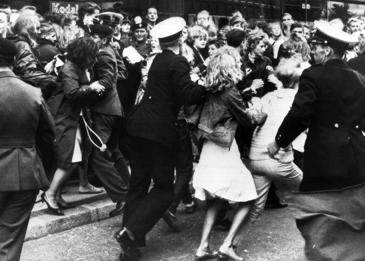 Beatles fans in Copenhagen, Denmark, before the band arrived at the Royal Hotel, June 4, 1964. Via the Atlantic, AP.